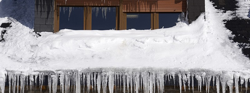 Ice Damming can damage your roof and gutter system. Call Ned Stevens today to remove ice dams.
