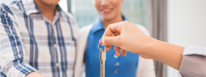 new homeowners getting the keys to their new home