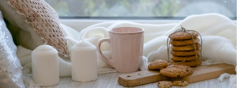 cozy hygge home settings with warm drinks and treats