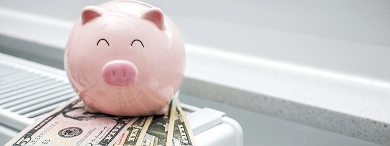 piggy bank sitting on radiator