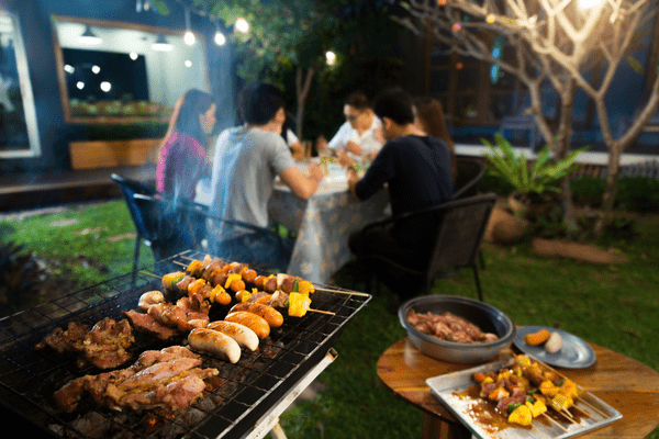 people eating on patio outside home at night