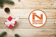 Ned Stevens Gutter Cleaning logo next to a wrapped gift.