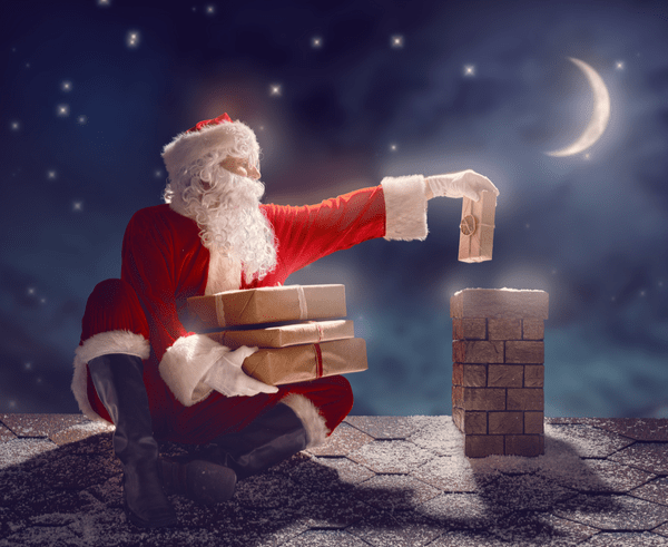 Santa sending presents down a chimney.