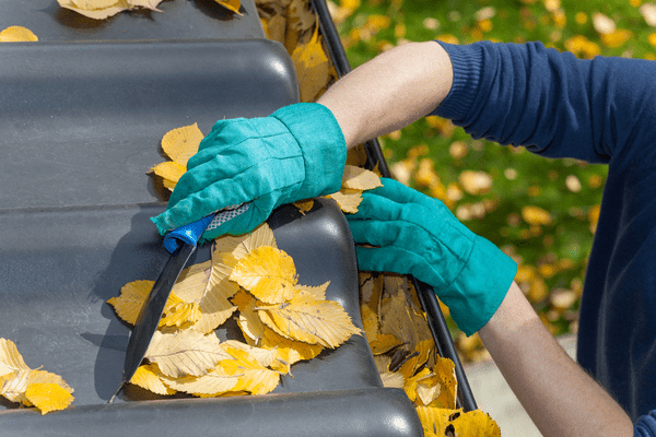 Hands cleaning gutters