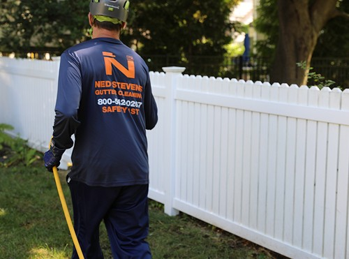 Fence cleaning with soft wash